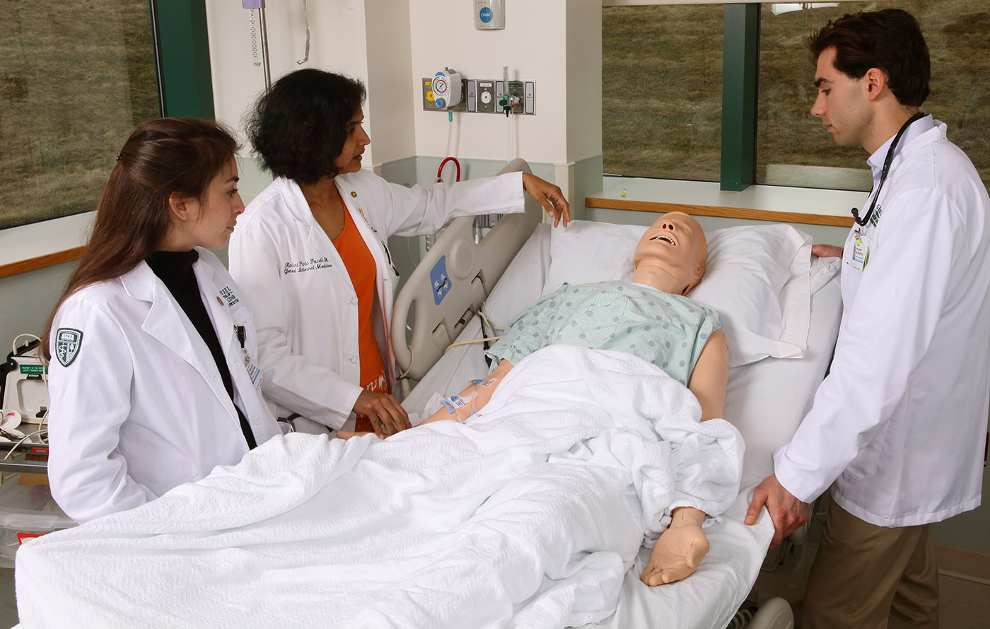 Medical students work with Dr. Roshini Pinto-Powell at the Dartmouth-Hitchcock Simulation Center