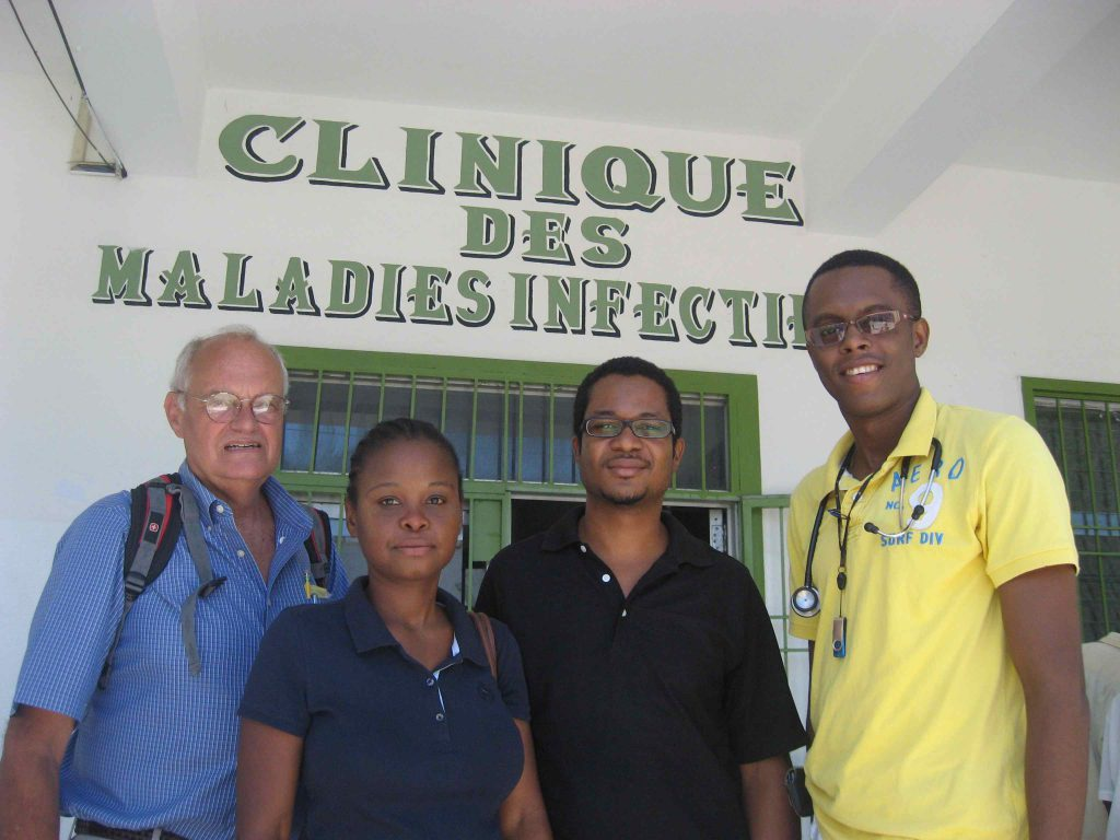 Dr. Peter Wright (left) with staff members of Hopital Imaculee Conception in Les Cayes, outside the Infectious Disease ward. (Photo courtesy of William Young, MD)