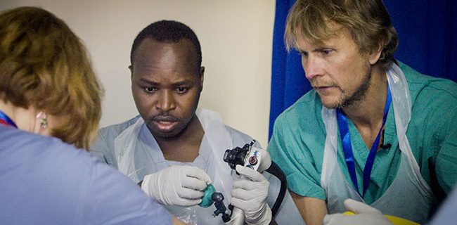 Dr. Steve Benson teaching colleagues in Rwanda.