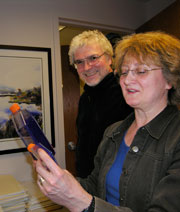 David Bzik (left) and Barbara Fox examine flasks for infection