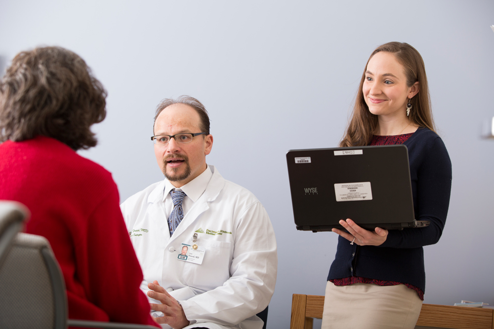 Dr. Gary Freed and Geisel medical student Asha Clark '16, talk to a patient she is assigned to helping as a PSC volunteer.