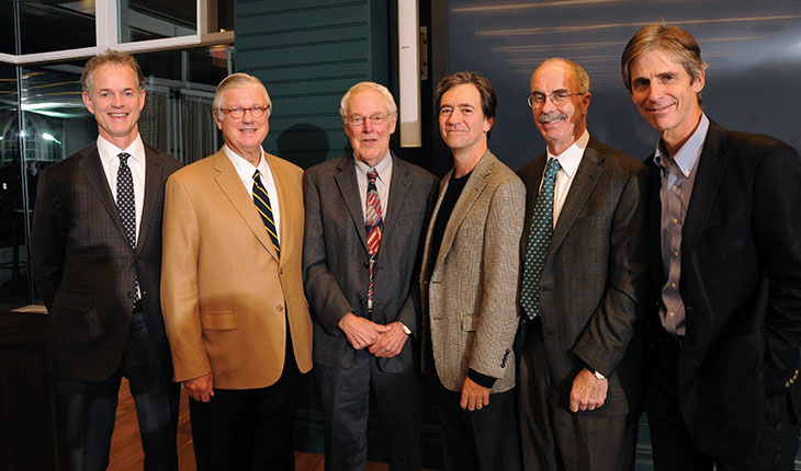 Chris McKown, George Bennett, and Kevin Kimberlin—who, together, led the fundraising campaign to support the distinguished professorship—are pictured here (left to right) with Jack Wennberg (center), Dartmouth President Phil Hanlon (second from the right), and Elliott Fisher (far right). Photo by Jon Gilbert Fox.