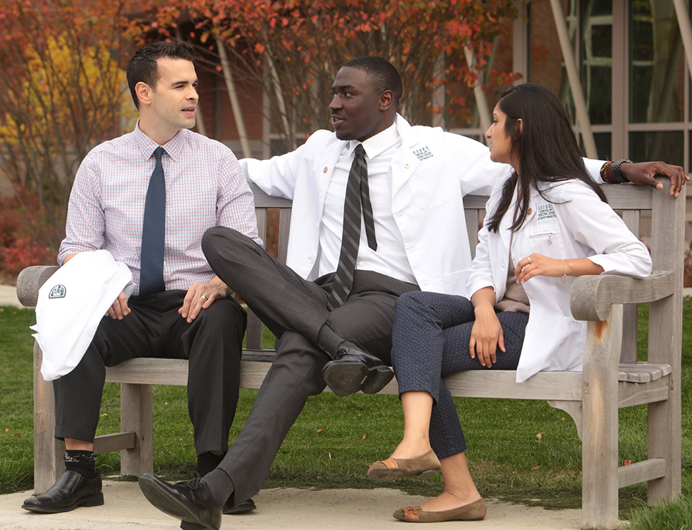 Inyang Udo-Inyang (center) with his fellow medical students Chris Navas and Khushboo Jhala.