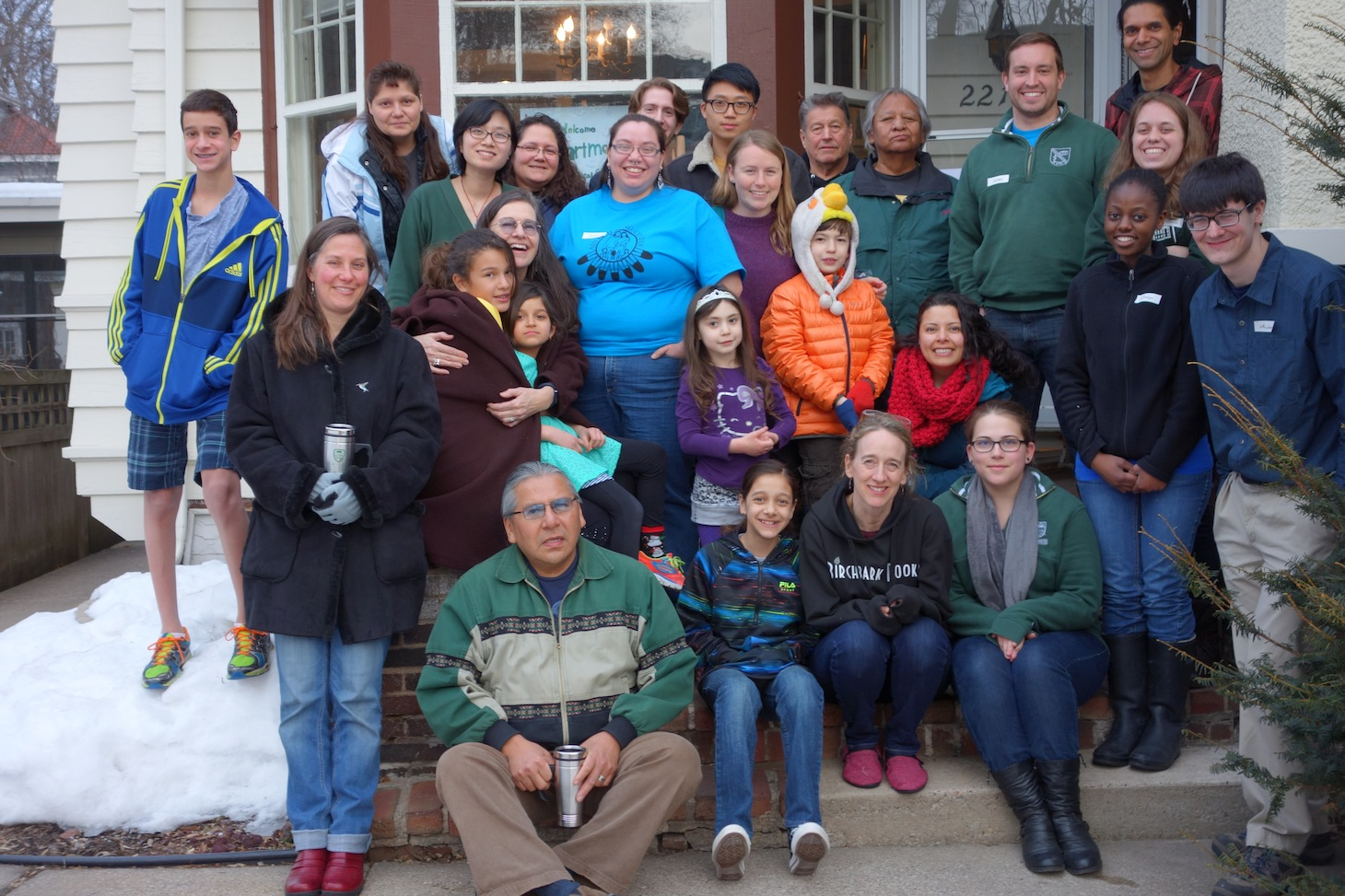 Angela Erdrich, MD, DC '87, Geisel '94 (front row, second from the right), and her husband, Sandeep Patel, MD (back row, far right) hosting Geisel students at their home during the 2014 alternative spring break trip to Minnesota. Erdrich and Patel work with American Indian communities in Minneapolis and in South Dakota, and serve as mentors to Geisel students.