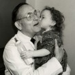 W. Hardy Hendren III, MD, D'47, MED'50 is shown here with a pediatric patient.