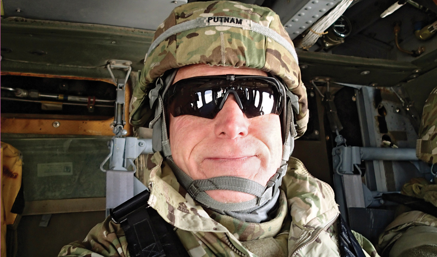 Matthew Putnam on a helicopter during his time with a forward surgical team in Afghanistan.