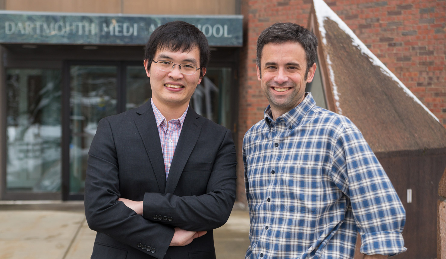 Lin Deng, PhD '15, with James Mosely, PhD, Assistant Professor of Biochemistry. Photo credit: Eli Burakian