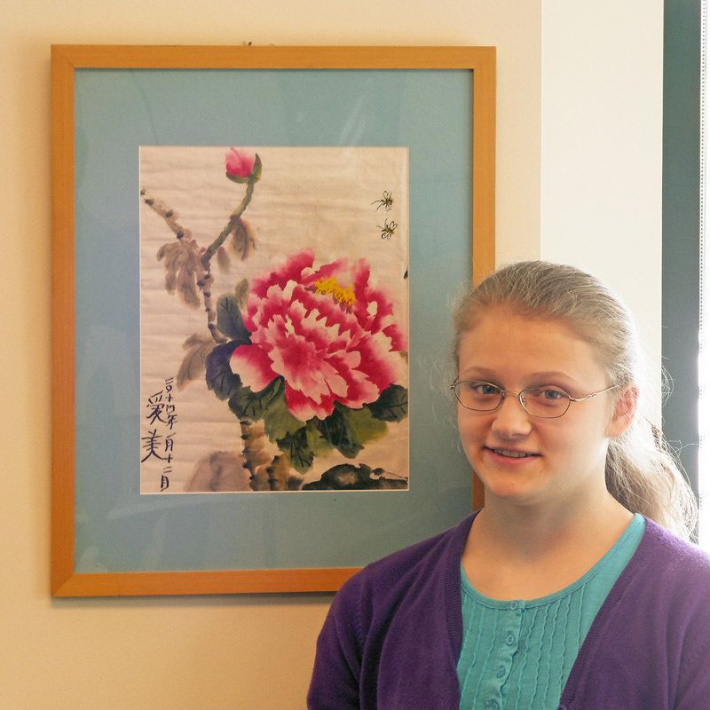 Abigail Ham with her Chinese flower painting (photo by Harmon Clark)