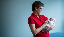 Christine Taylor is one of the volunteer cuddlers in the Geisel/CHaD project that developed a new model of care for in utero opioid-exposed and Neonatal Abstinence Syndrome-affected newborns. Photo by Mark Washburn.