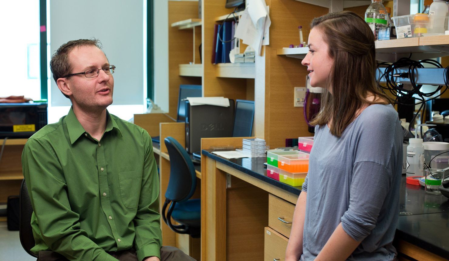 Todd Miller, PhD, and Geisel graduate student Riley Hampsch, are investigating how some breast cancer cells dodge treatment, lie dormant in the body, and then form new tumors years later. Photo by Rob Strong.