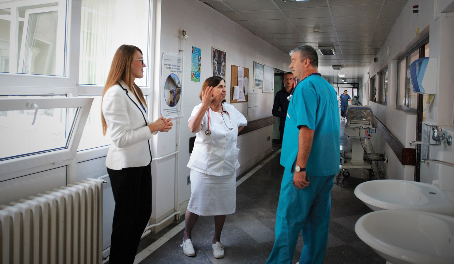 Mrika Aliu consults with physicians and staff at the Neonatology Intensive Care Unit in Prishtina, Kosovo.