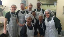 Aaron Briggs and fellow Geisel School of Medicine Urban Scholars and Xavier University undergraduates in New Orleans serving lunch at Ozanam Inn, a homeless shelter.  Front Row, left to right: T'Yanna Jackson, Miyah Davis, Torhianna Haydel, and Sarah Ghabbour '19.   Back row, left to right: Courtney Hanlon '19, Timothy Harris '19, Aaron Briggs '19,  and Spencer McFarlane '19.