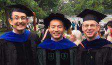 Chris Amos (left), David Qian, and Interim Dean Duane Compton at the Graduate Investiture Ceremony.