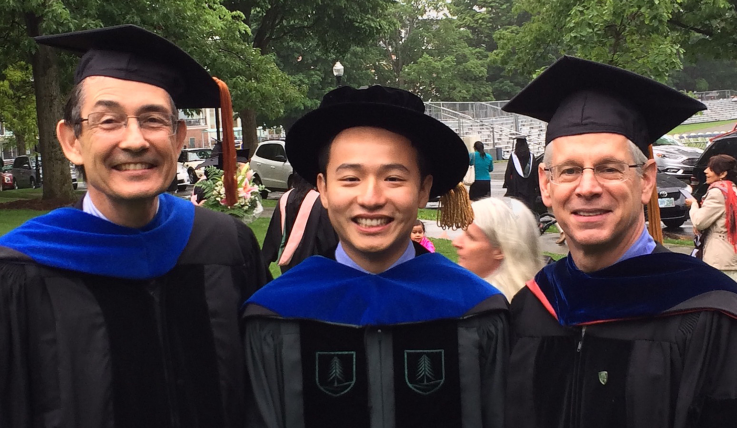 Chris Amos (left), David Qian, and Interim Dean Duane Compton at the Graduate Investiture Ceremony.