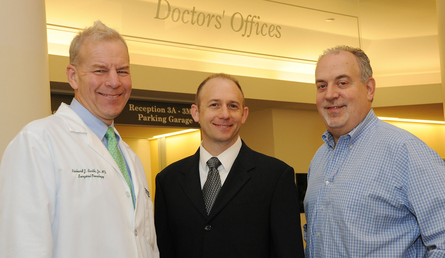 SYNERGY Clinician-Entrepreneur Fellowship (S-CEF) fellows Richard Barth, Jr. (left), MD, and William Hudenko (center), PhD, with Aaron Kaplan, MD, who leads the Academic-Industry Core for SYNERGY and developed the S-CEF. (photo by Jon Gilbert Fox)