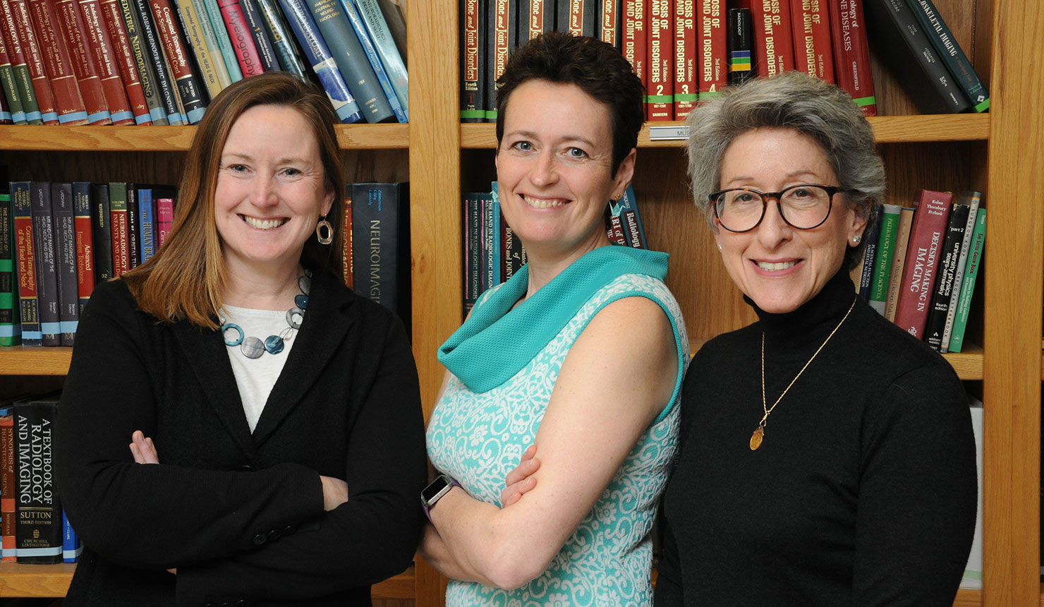Nancy McNulty (left), Petra Lewis (center), and Jocelyn Chertoff (right) all received awards from the Association of University Radiologists for their contributions to the field of radiology. (Photo by John Gilbert Fox)