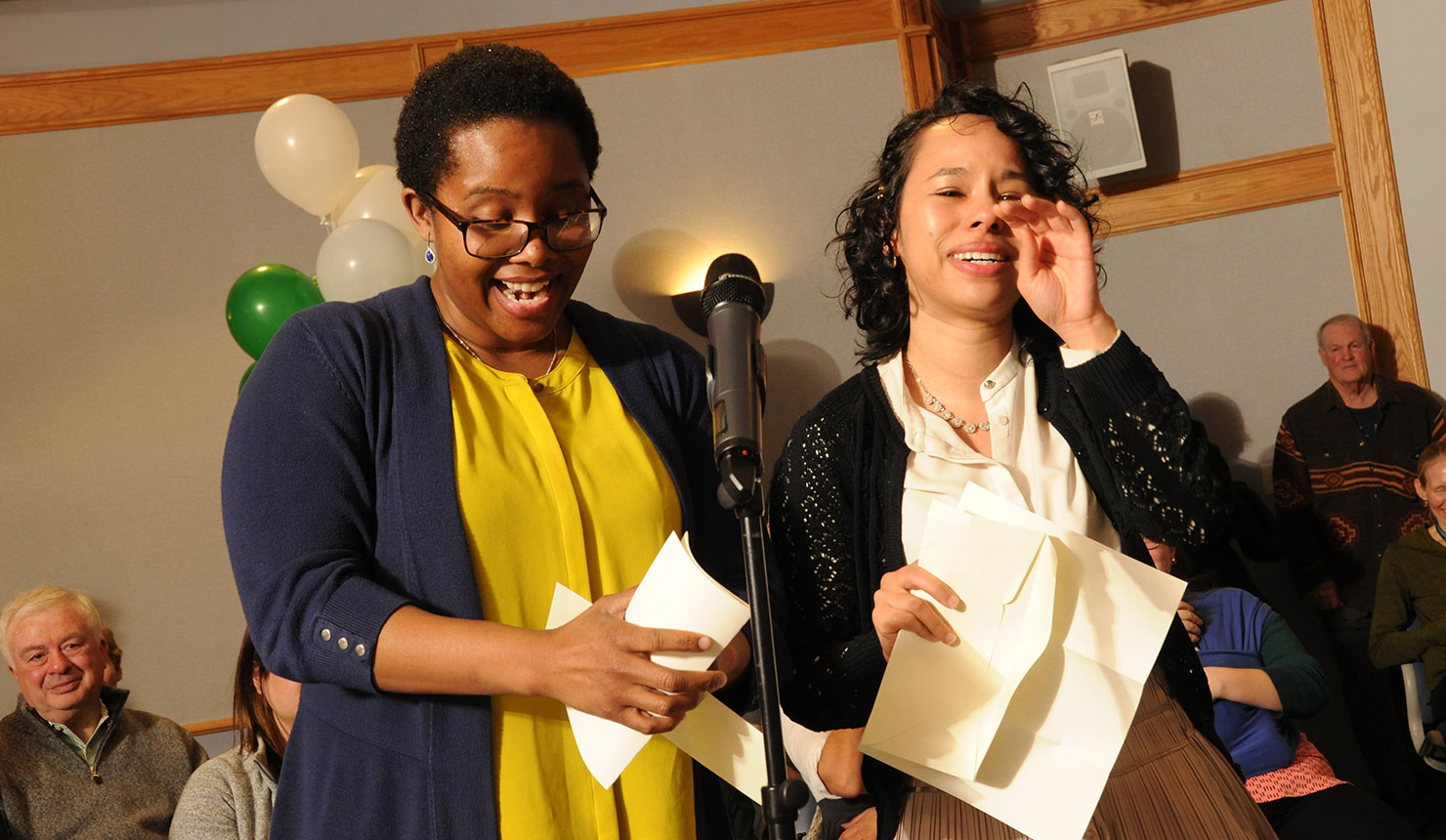Best friends Asia Peek (left) and Lovelee Brown (right) open their Match Day letters together. (photo by Jon Gilbert Fox)