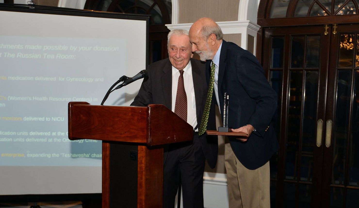 James C. Strickler, MD (left), and George A. Little, MD, FAAP (right), received their awards at an event at the Yale Club in New York City. (Photo courtesy of Action for Mothers and Children)