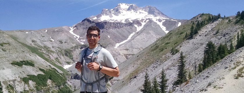 Marcel Brown '21 poses in front of Oregon's Mount Hood.