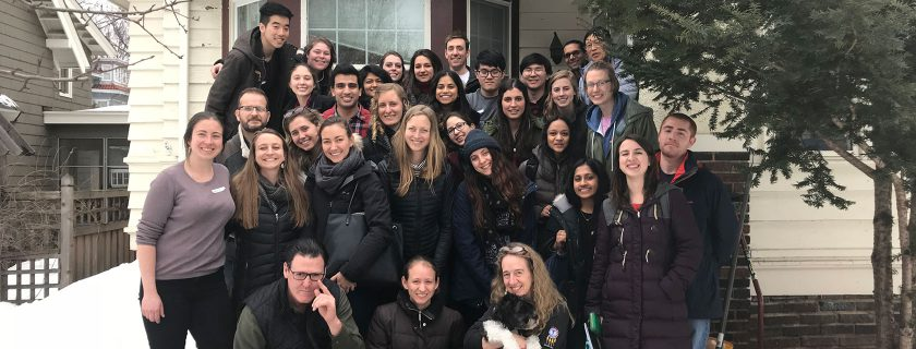 Students at the home of Dartmouth and Geisel alum Dr. Angie Erdrich (front row on the right)