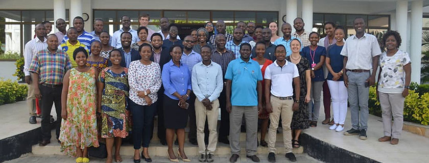 Attendees of the TB Symposium: Critical Updates in TB Care and Prevention in Dar es Salaam, Tanzania. The symposium was a joint effort by Geisel's DarDar programs and Muhimbili University of Health and Allied Sciences, and Tanzania's National TB and Leprosy Programme and National AIDS Control Program.
